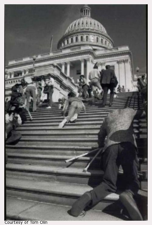 Photograph of ADA protestors crawling up Capitol Builidng steps.