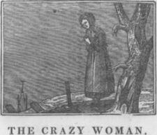 A woman stands next to tree in a cemetery.