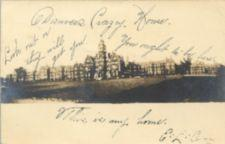 A picture of large insitution buildings with a handwritten message.