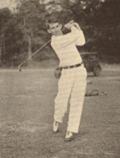 A young man swings a golf club.