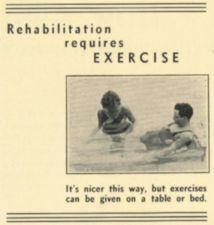 A physical therapist works on a man in a pool.